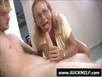 Mom wearing glasses gives this young dude a blowjob with daughter