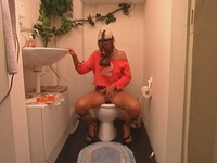The jocky girl pissing into toilet