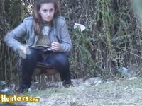 Brunette babe pissing in the wilds