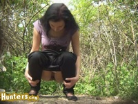 Sweet brunette pissing outdoors